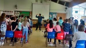 Children's choir rehearsing The Rain Queen